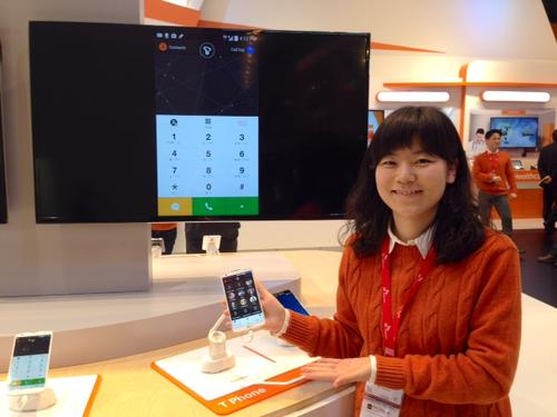 Silver Ryu, manager of the product planning division at SK Telecom, shows off T-Phone, the carrier's reinvented Android dialer.