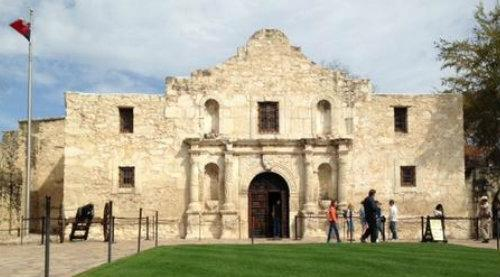 The site of the Battle of the Alamo in 1836 stands tall in San Antonio, surrounded by even taller buildings, wax museums, old-timey photo booths, tacky T-shirt stores, and haunted adventure tourist traps.