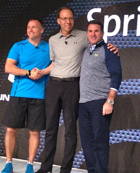 Sprint CEO Dan Hesse (center) buddies up to Under Armour CEO Kevin Plank and trainer and coach Todd Durkin as the trio announce a partnership to bring health apps to the Samsung S5 Sport on Sprint's network.