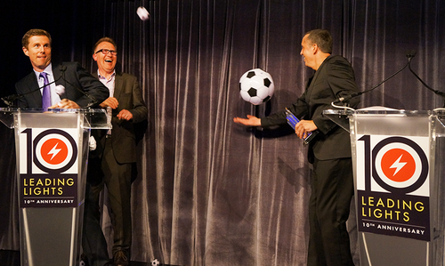 Ciena senior VP of Product Marketing Rick Dodd (left) battles his way to collect the Best New Product (Telecom) award from Light Reading CEO Steve Saunders (right) as balls of multiple sizes join him on stage. Meanwhile, Light Reading Editor-in-Chief Ray Le Maistre makes a futile attempt to catch one of the balls in his mouth... Ciena won the award for its WaveLogic Photonics solution.