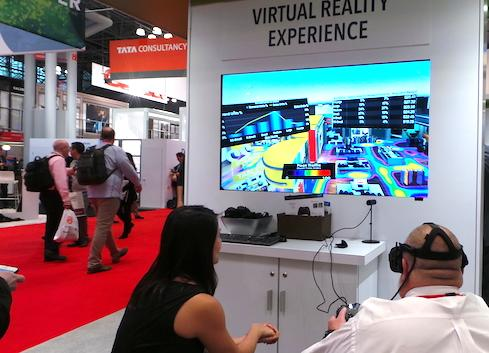 A customer experiences VR analytics in the SAS booth