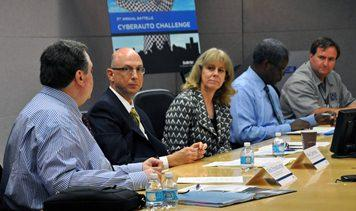 Left to right: Rob Strassburger, vice president of vehicle safety and harmonization at the Alliance of Automobile Manufacturers;  Mike Cammisa, director of safety at the Association of Global Automakers; Lisa McCauley, vice president and general manager of Battelle Cyber Innovations;  Andrew Brown Jr, vice president and chief technologist, Delphi Automotive PLC; Karl Heimer, director of Battelle Center for Advanced Vehicle Environments