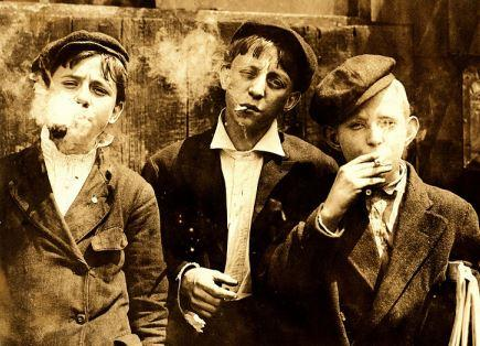 By Lewis Hine - Lewis Hine: Newsies smoking at Skeeter's Branch, St. Louis, 1910, based on file from Library of Congress, Public Domain, https://commons.wikimedia.org/w/index.php?curid=11158385