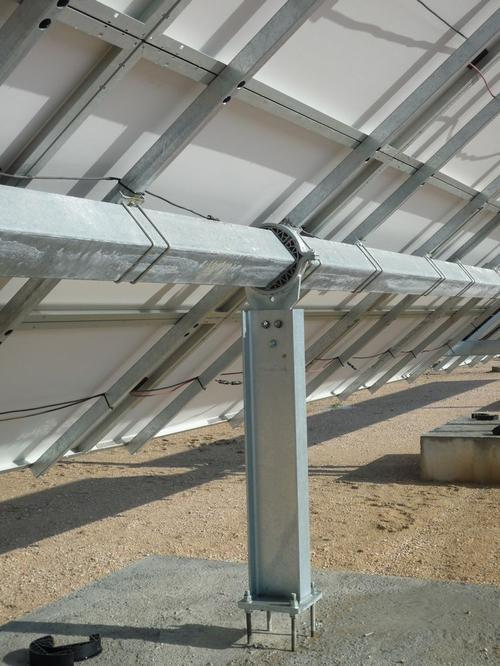 A custom-made part, shown in the middle of the photo, supports the movement of solar panels.  Source: igus