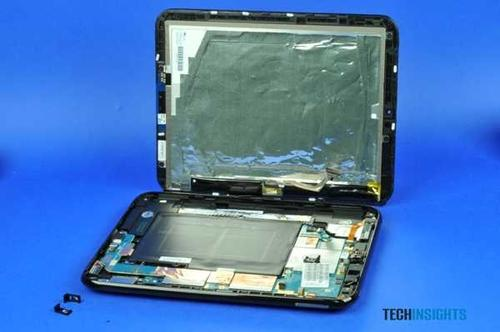 Opening the HP TouchPad enclosure reveals the display on top and the main board and battery on the bottom.