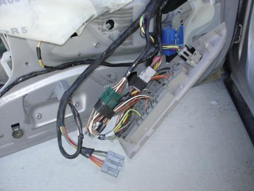 The wiring harness controlling the windows and door locks in the author's 1996 Mercury.
