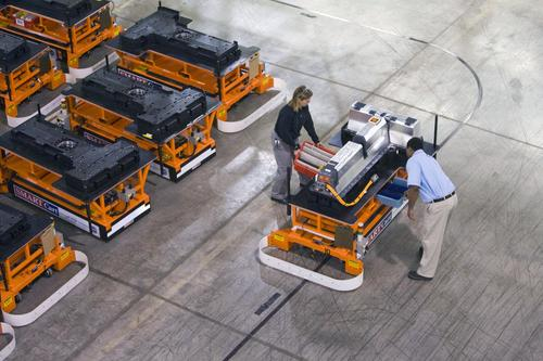 Plant workers at GM's Brownstone Battery plant use an automated guided cart (AGC) to assemble lithium-ion batteries for the Chevy Volt. (Photo courtesy of GM.)