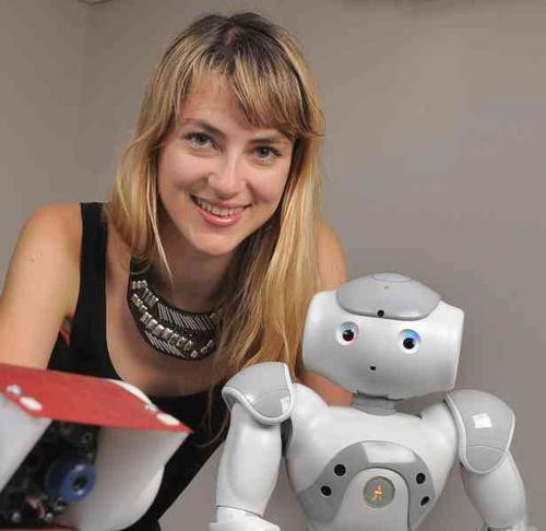 Heather Knight, a roboticist and founder of Marilyn Monrobots, is trying to bridge the uncanny valley by adding humor to the robotic repertoire. Her robot, Data, can do imitations of Darth Vader, R2D2, and Buzz Lightyear.  (Photo courtesy of Freescale Semiconductor.)