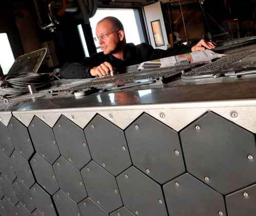 Project manager Peder Sjorlund surveys electronically heated tiles that act as independently   addressable to generate custom IR signatures.  (Photo courtesy of BAE Systems.)