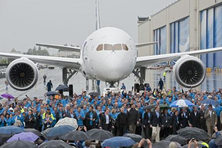 Boeing and All Nippon Airways (ANA) employees celebrate the delivery of the first 787 Dreamliner on September 26 