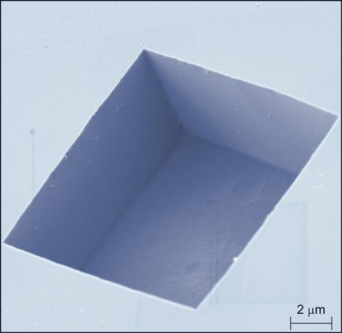 This image shows the box-like shape of a pit the NIST team etched into a diamond surface  and the pit's smooth vertical sidewalls and flat bottom.  (Photo courtesy of NIST.)