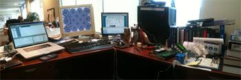 The laptops on the desk of Mike Burr, Jacksonville, Fla. are laid out in a panorama.