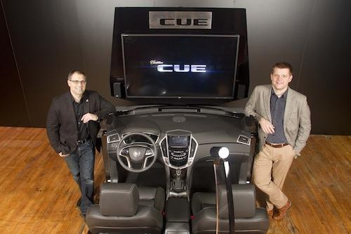Engineer Mike Hichme (left) and designer Stuart Norris (right): GM's design and engineering teams colocated in an effort to understand the customer's needs and choose the right technologies to support those needs.