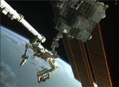 The Dextre robot in NASA's predecessor Robotic Refueling Mission transfers and installs the tools module onto its permanent home on the International Space Station.   (Source: NASA)