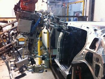 KWD Automotive uses 3D machine vision on industrial robots that assemble car doors.