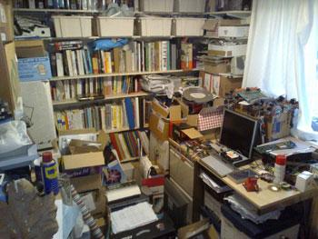 Nicholas Lee of Salisbury, Wiltshire, UK, shows off 'my vast hoard of electronic components, reference books, datasheets, and a miscellany of electronic projects under construction,' which reside next to his desk.