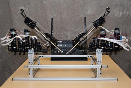 Based on the open source Robot Operating System, the surgical robot Raven II, shown here with control electronics, will give researchers at several universities a common hardware and software platform for developing next-generation surgical robots.   (Source: University of Washington)