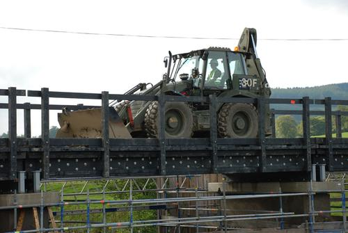 Recycled plastic bottles and other waste plastic destined for landfills can be transformed into weight-bearing structural materials for heavy-load bridges, such as this one in Scotland, 