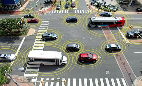 In a vehicle-to-vehicle scenario, cars and trucks would 'talk' to each other via a short-range 5.9GHz frequency band. (Source: National Highway Traffic Safety Administration) 