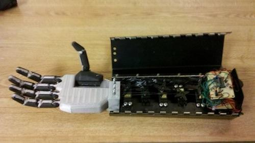 The PIC for the hand is mounted on one of two protoboards along with the other required electrical components, and the protoboards are mounted vertically in the base of the forearm.