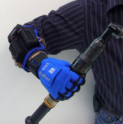 GM's Robo-Glove incorporates four tiny servo motors, four gearheads, and four ball screws, along with a lithium-ion battery, in a package worn on the forearm. The motors apply force through synthetic tendons attached to the fingers. (Source: GM)