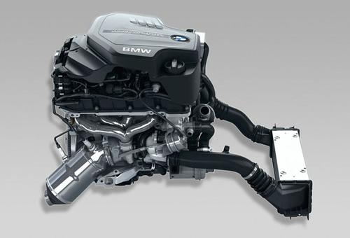 BMW's TwinPower Turbo four-cylinder combines direct fuel injection, Double-Vanos variable camshaft timing, Valvetronic variable valve timing, and twin-scroll turbocharging.   (Source: BMW)