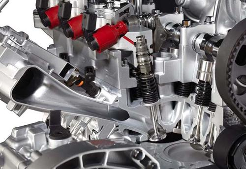 Fiat's 1.4-liter Multi-Air inline four-cylinder engine features Fully Variable Valve Actuation. The intake valves replace traditional overhead cam systems with hydraulic actuation controlled by four fast-responding solenoids. As a result, the engine delivers instantaneous air-fuel adjustment at any time in the engine cycle for maximum efficiency and power. Solenoids can be seen in red in this photo. (Source: Fiat)