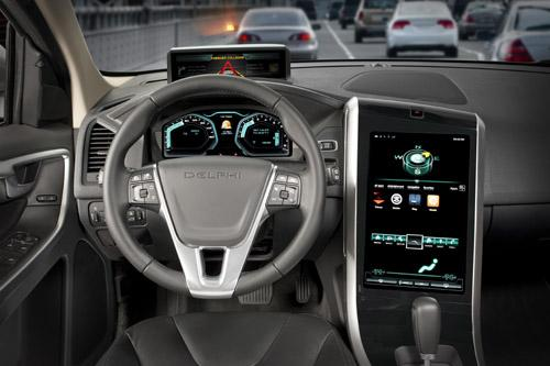 Delphi's MyFi Connecting with Safety system uses an LED-based 'exogenous display' (see top of dashboard) to draw the driver's attention back to the road.   Source: Delphi Corp.