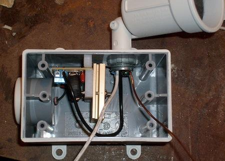 The auxiliary lamp and control combination is hard wired to the CFL overhead lights, so it turns on only when the light switch is thrown, and always turns off when the lights are shut off.