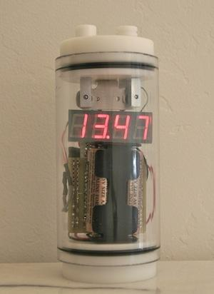 The timer is encased in a transparent, waterproof polycarbonate tube and can go to the bottom of the pool without leaking.