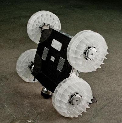 The four-wheeled 11-lb Sand Flea robot can jump 30 ft into the air, and uses gyro-stabilization to stay level during flight and ensure a smooth landing.   (Source: Boston Dynamics)