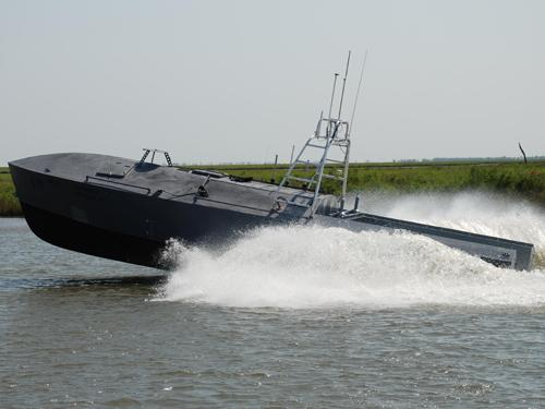 Textron Land and Marine System has successfully demonstrated its Custom Unmanned Surface Vessel, which it aims to sell to the US Navy to perform risky missions like minesweeping and approaching enemy sea vessels.   (Source: Textron)