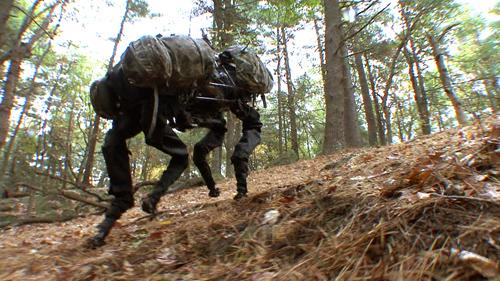 The Boston Dynamics BigDog is packed with sensors and powered by an engine that drives a hydraulic activation system. The robot is about three feet long and weighs 240 pounds. It can walk, run at 4mph, climb 35-degree slopes, and carry 340 pounds. The project is funded by DARPA's Tactical Technology Office. (Source: Boston Dynamics)