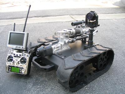The Machine Lab's MMP-30 Mechanical Mobile Platform is used for explosive ordnance disposal in Iraq. It weighs 50 pounds (including control unit), measures about 23 inches long when collapsed, and can be carried in a backpack. Its pan/tilt color infrared camera has 180-degree pan and 150-degree tilt. The robot also sports a color, wide-angle gripper camera and a color, wide-angle rear-facing camera. The four-axis arm has a 20-inch reach and can lift five pounds at full extension. (Source: The Machine Lab)