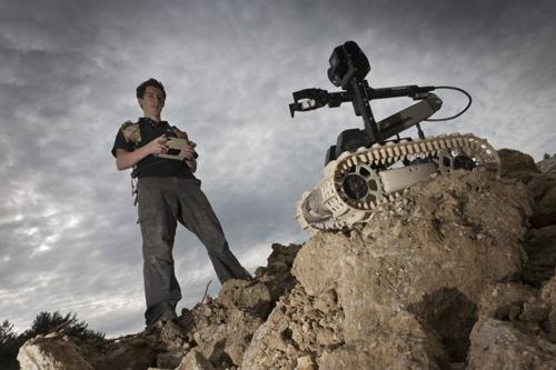 Originally designed for the US Marine Corps, QinetiQ's 20-pound Dragon Runner SUGV can be carried in a standard-issue pack. It allows users to see around corners and into tight spaces in urban environments, and it can be customized in the field. Its manipulator arm has a rotating shoulder, wrist, and fingers and can lift up to 10 pounds. Options include motion detectors, a microphone, pan/tilt/zoom cameras, day/night cameras, and extended radio frequency operation. (Source: QinetiQ)
