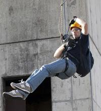 Student Dave Monk demonstrates the winch device.   (Source: BYU)