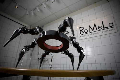 The Multi-Appendage Robotic System (MARS) from Virginia Tech's Robotics & Mechanisms Laboratory looks like a giant spider with six legs instead of eight. Fabricated out of carbon fiber and aluminum, the robot's legs are spaced axi-symmetrically around its body, which lets it walk omni-directionally. Each leg uses a proximal joint with two degrees of freedom and a distal joint with one degree of freedom for added strength and rigidity. The goal is to develop a walking gait system for negotiating terrain with variations in height. The system is based on simplified biological neuron networks, arranged in subnetworks and subsystems to support the operation of another neural network: a central pattern generator (CPG) that generates gait patterns based on feedback from all supporting systems. (Source: Virginia Polytechnic and State University)