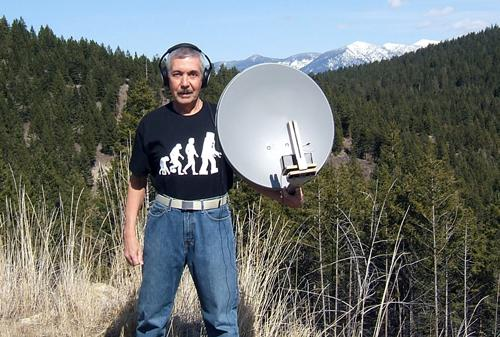Jerald Cogswell mounted a precision MEMS microphone in a satellite dish's focal point so it can feed its signal to an amplifier that enables simultaneous recording and monitoring via headphones.