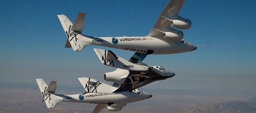 The SpaceShipTwo commercial spaceship and its launch vehicle, WhiteKnightTwo, shown here in glide test flights, have received FAA permission for experimental, rocket-powered, suborbital launch tests.   (Source: Virgin Galactic)