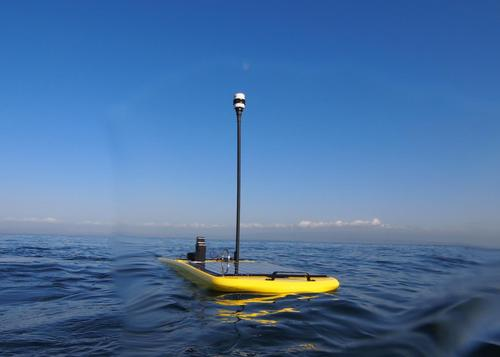 Liquid Robotics touts its Wave Glider wave-powered, autonomous, unmanned marine vehicle (UMV) as the world's first marine robot that can operate independently for a year or more at sea without needing maintenance. In fleets, the surfboard-sized robots can form data gathering networks. They are designed for predicting weather patterns, monitoring marine ecosystems, and gathering data about climate change, oil slicks, and algae blooms. Other applications include reconnaissance and surveillance. Their propulsion system mechanically converts wave motion into forward movement, and payloads are solar energy-fueled. Each weighs about 90 kg and has an average speed of about 1.5 knots. Recently, four of them broke a world distance record for unmanned devices, traveling more than 3,200 nautical miles across the Pacific Ocean.   (Source: Liquid Robotics)