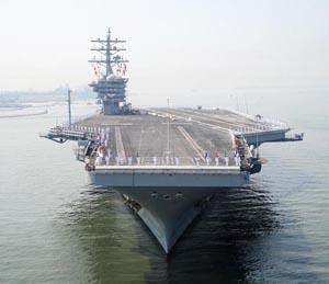 The Navy has granted University of Wisconsin researchers $2 million to develop a tool that can model the performance of biofuels to help identify one it can use to power aircraft carriers, like the one shown, as well as submarines and other seafaring vehicles. The work is part of the military's ongoing interest in exploring alternative methods to fossil fuels for energy.   (Source: Navy)