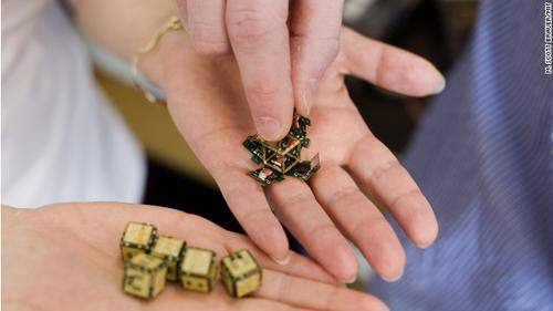 Tiny robotic cubes self-assemble to duplicate an object that is placed in a heap of the cubes. Possible applications include rapid prototyping and replacing parts or objects. (Source: M. Scott Brauer/MIT)