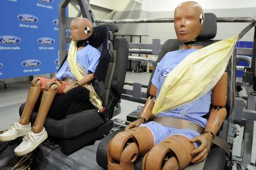 In 2009, Ford introduced the industry's first production inflatable seat belts, which are designed to spread crash forces over five times more area of the body than conventional belts. Used for rear-seat occupants, the inflatable belts help reduce pressure on the chest and control head and neck motion. (Source: Ford Motor Co.)