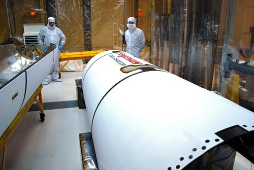 The two halves of the the Pegasus XL payload fairing's composite shell are shown here being cleaned and inspected at Vandenberg Air Force Base before the spacecraft is encapsulated.   (Source: NASA/Randy Beaudoin, Vandenberg Air Force Base)