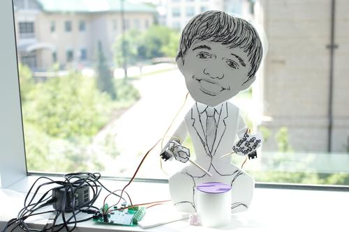 This crafty little man, powered by the Hummingbird kit, plays a drum. (Source: Carnegie Mellon University)