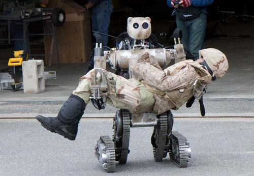 A different way of making rescue robots friendlier is designing them to look more like people, and making them big and strong enough to lift and carry unconscious disaster victims for long distances without hurting them. One example is the Battlefield Extraction Assist Robot (BEAR) prototype, built by Vecna Robotics and funded by the US Army Medical Research and Materiel Command's Telemedicine and Advanced Technology Research Center. The BEAR, an all-terrain, search-and-rescue, humanoid robot, can lift and carry up to 500 pounds. It's designed to locate, lift, and rescue people, and it can grasp fragile objects without damaging them. The powerful torso and arms are controlled by hydraulics, and its mobility platform has two independent sets of tracked legs. The robot balances itself on the balls of its ankles, and it can remain upright while balancing on its knees or hips. Aside from search and rescue, it can be used for handling hazardous materials, surveillance and reconnaissance, mine inspection, heavy lifting, and warehouse automation. (Source: US Army)
