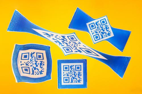 A new shape-memory plastic that makes QR code labels look like Salvador Dali's famous floppy watch could prove useful in product and brand protection. Since codes can be read only when the labels are in their permanent, original shape, labels can store information that makes products tough to counterfeit.   (Source: Bayer MaterialScience)