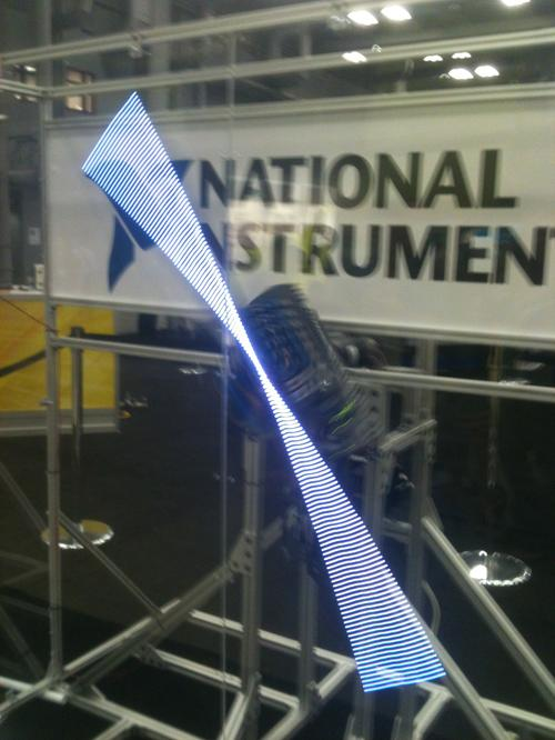 A strip of LEDs attached to a motor spins around and displays a moving image. It takes a fair amount of computational power to display each of the images.