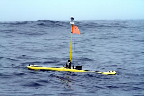 The solar-powered Wave Glider includes an acoustic receiver that tracks the location of sharks. Information from the tags is transmitted along a network of buoys in areas where sharks are known to congregate and connects to an iPhone/iPad app so users also can follow the sharks, as well as view interactive maps and information about them.   (Source: Stanford University)