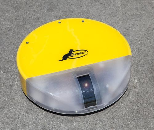 The radio-controlled, Roomba-shaped Ferret under-vehicle inspection robot can transmit real-time video images to an operator up to 300 meters away.   (Source: General Robotics)